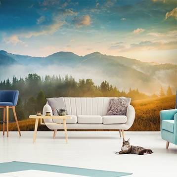 Wall mural for the living room - Mountains and forest in the fog