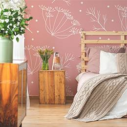 Wall mural - Subtle dandelions on a pink background