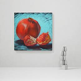 Canvas Print - Pomegranate fruit on a blue background