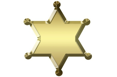 Blank golden sheriff star isolated on white background.