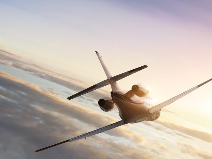 Vinylová fototapeta Tryskové letadlo na letu do západu slunce - Vinylová fototapeta
