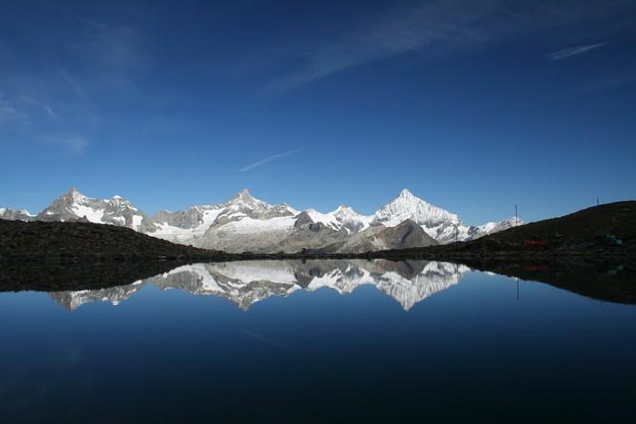 Vinylová Tapeta Švýcarské Alpy - Outdoorové sporty