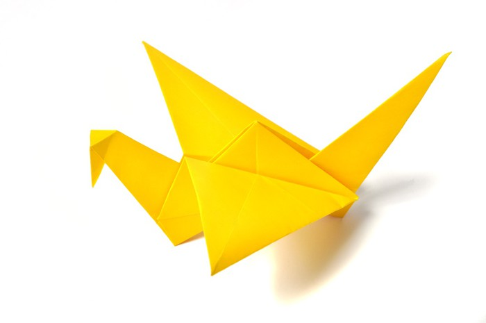 Yellow origami crane over white Wall Mural • Pixers® • We live to change