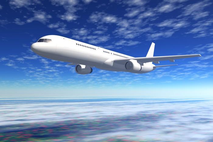 Vinylová Tapeta Cestující letadlo letu na modré obloze - Témata