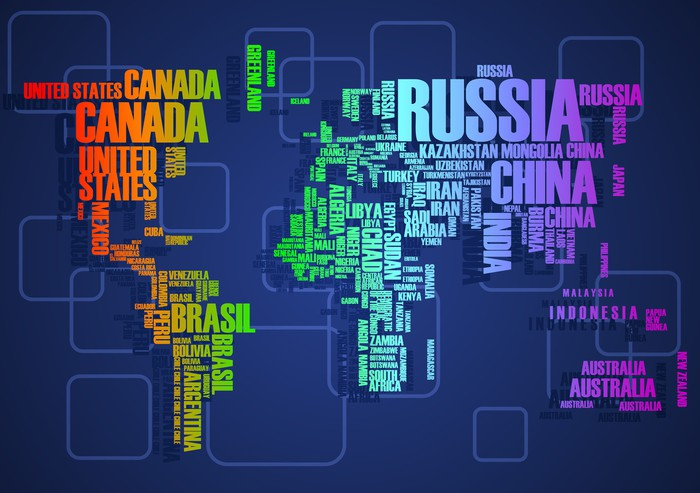 Papier Peint Vinyle Carte du monde: les contours du pays se compose des mots - Concepts
