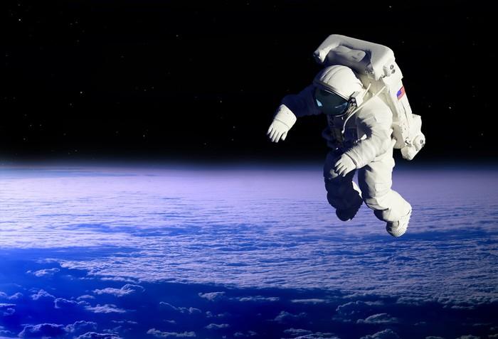 Niño Astronauta En El Espacio: Fotomural El Astronauta • Pixers®