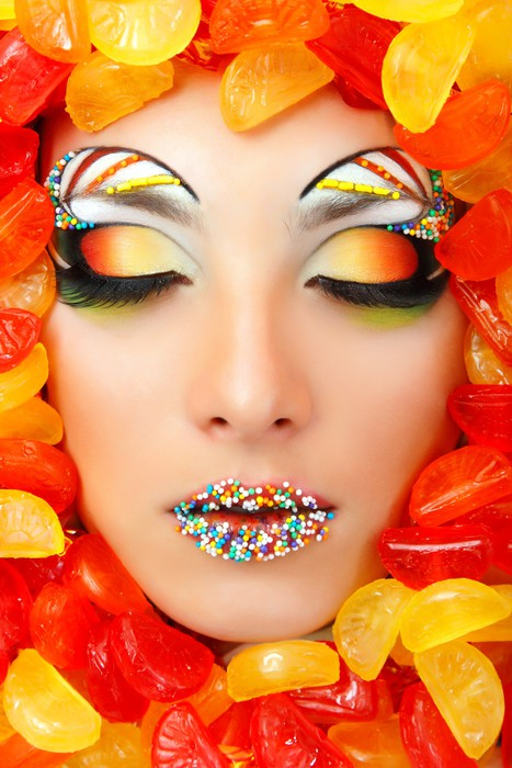 woman sweet candy caramel with beautiful make-up young