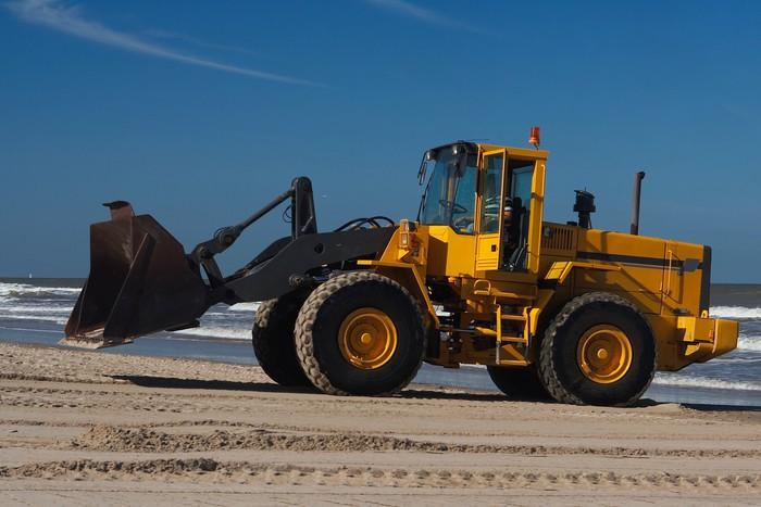 Vinylová Tapeta Bagr pohybující se písek na pláži. - Těžký průmysl