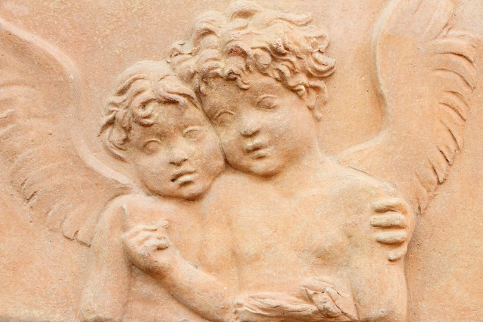 two angels holding together - terracotta relief Wall Mural • Pixers ...