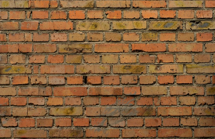 Carta da parati frammento di vecchio muro di mattoni con for Carta da parati muro di mattoni