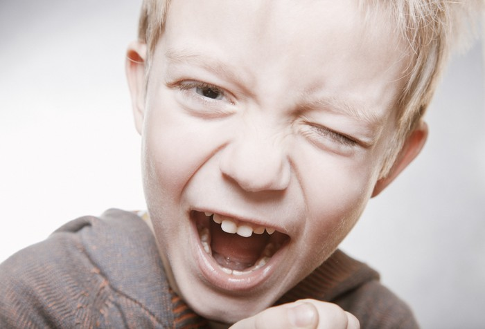 portrait of a young boy screaming wall mural pixers we live to