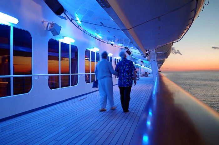Elderly Couple Walking On Cruise Ship Deck in Evening Vinyl Wallpaper - Boats