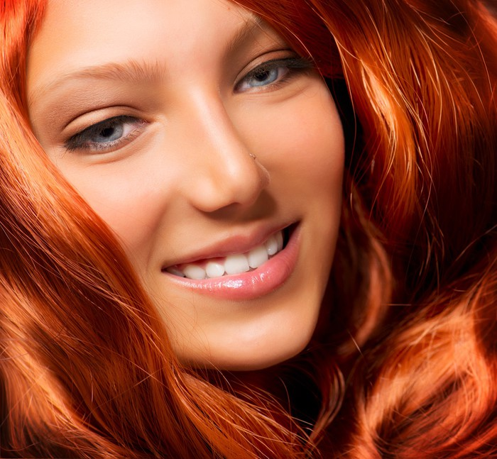 Beautiful Girl With Healthy Long Red Curly Hair Extension Wall