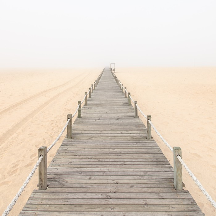 wooden footbridge on a foggy sand beach background portugal wall mural pixers we live to. Black Bedroom Furniture Sets. Home Design Ideas