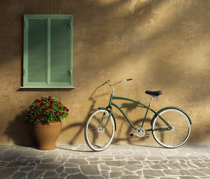 Papel de Parede em Vinil Tuscan stucco wall, doorway antique romantic vintage bicycle - Bicicletas