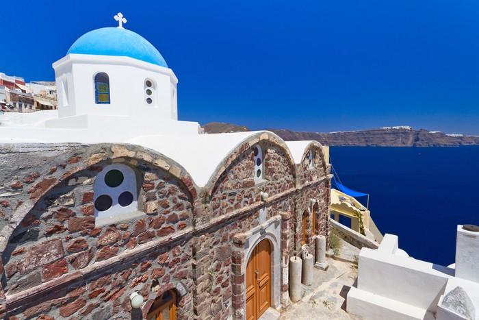 Vinylová Tapeta Modrá a bílá kostel vsi Oia vesnice na ostrově Santorini. Řecko - Evropa
