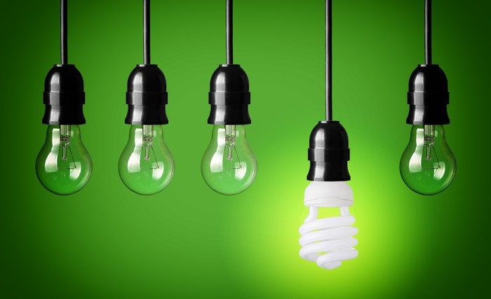 Idea concept with light bulbs and energy save bulb wall mural idea concept with light bulbs and energy save bulb vinyl wall mural business concepts aloadofball Image collections