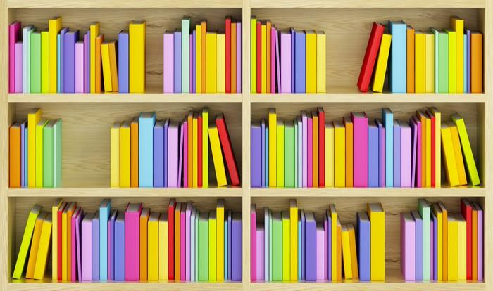 Carta da parati libreria con libri multicolori pixers for Carta da parati libri