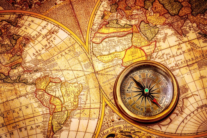 Vintage compass lies on an ancient world map wall mural pixers vintage compass lies on an ancient world map vinyl wall mural themes gumiabroncs Image collections