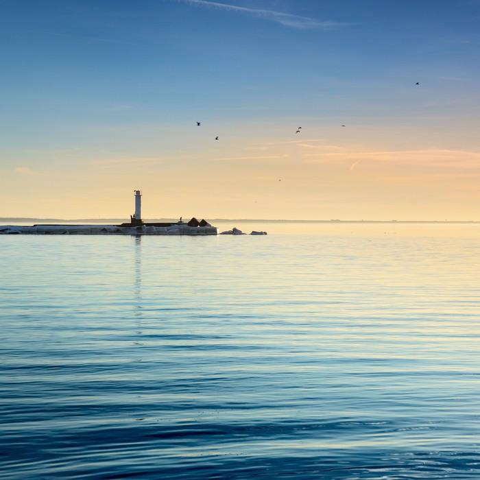 Plakát Maják v moři na barevný západ slunce - Infrastruktura