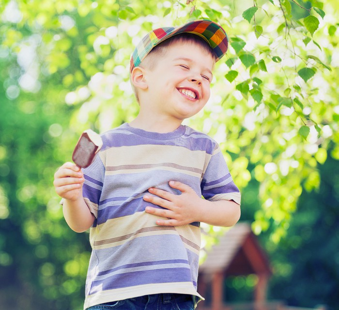 contented small boy eating an ice cream wall mural pixers we