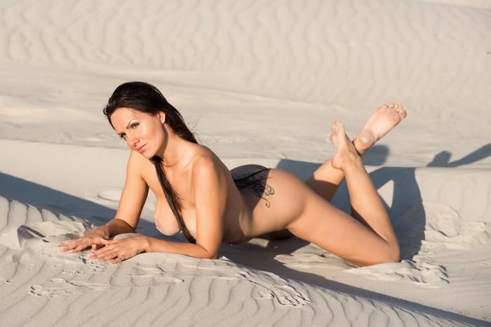 sunbathing on beach Nude woman