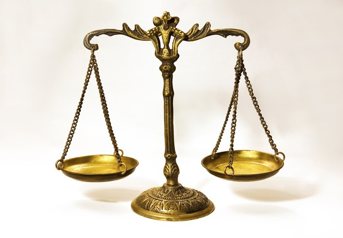 an antique scale that in formation of balance justice scale wall
