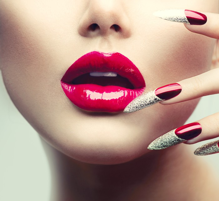 Makeup and Manicure. Red Long Nails and Red Glossy Lips Wall Mural ...