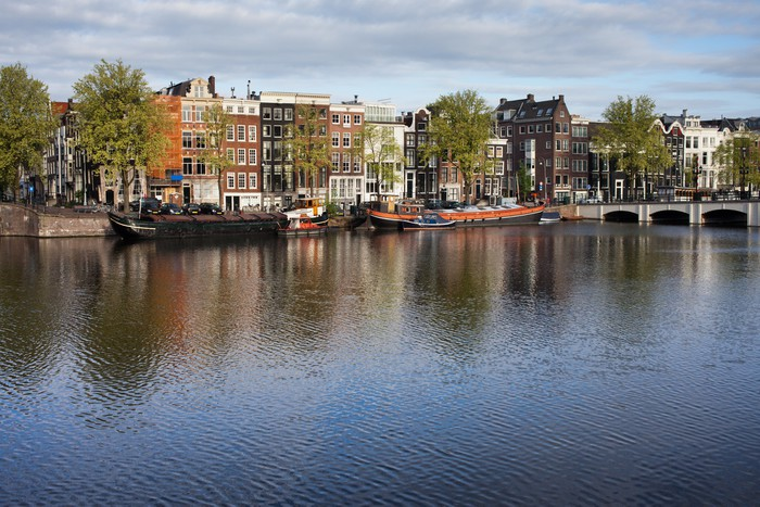 fototapete stadt amsterdam river view pixers wir. Black Bedroom Furniture Sets. Home Design Ideas