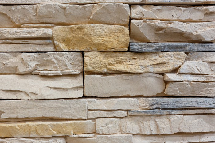 Tableau sur toile motif de mur en pierre de fond pixers for Motif sur mur