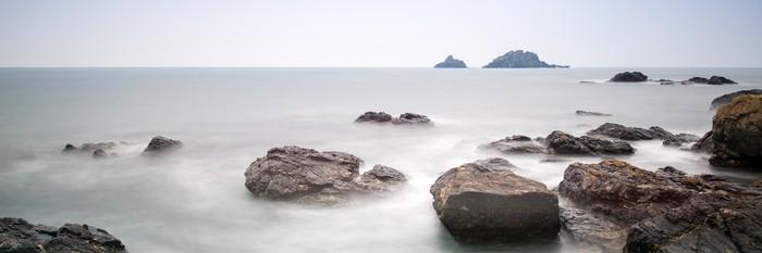 Vinylová Tapeta Panorama Krajina skalnatého pobřeží při východu slunce - Nebe