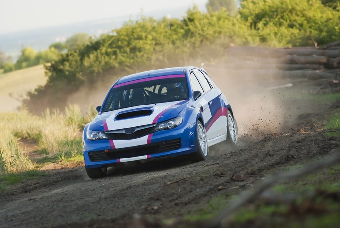 Rally car in action - gravel Vinyl Wallpaper - Extreme Sports