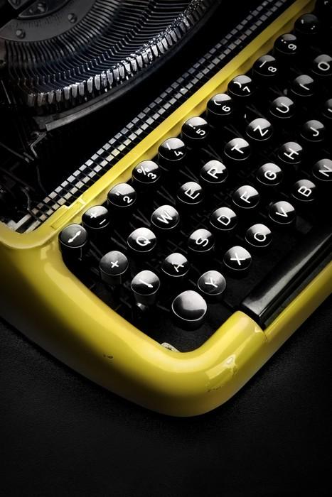 Tableau sur Toile Vieille machine à écrire jaune dans l'ombre - Fournitures de bureau