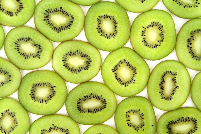 Vinylová Tapeta Kiwi plátky pozadí, zblízka obraz - Ovoce