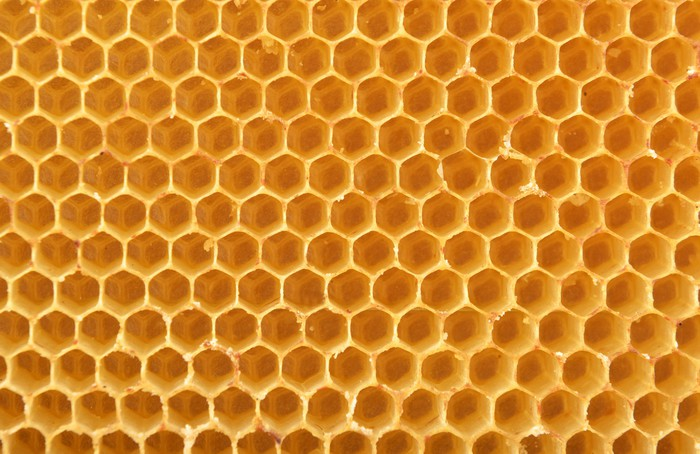 Honeycomb background wall mural pixers we live to change honeycomb background vinyl wall mural textures voltagebd Image collections