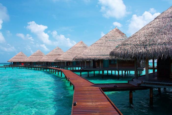 Papier Peint Vinyle Villas eau dans l'océan. Maldives. - iStaging