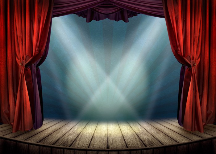 Theater Stage With Red Curtains And Spotlights Wall Mural