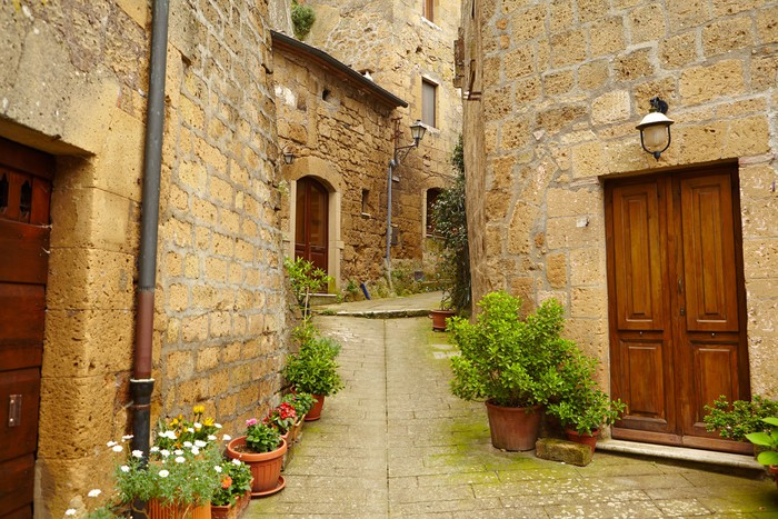 Vintage street decorated with flowers Tuscany Italy Wall Mural