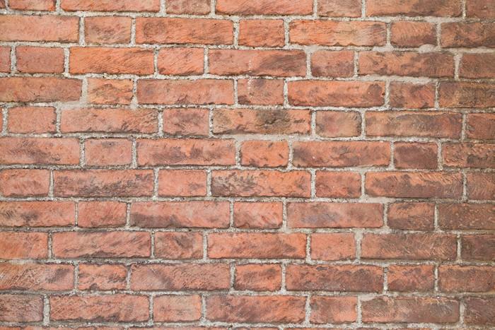 Carta da parati illuminata dal sole muro di mattoni rossi for Carta da parati muro di mattoni