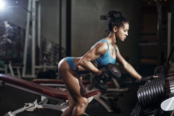 Vinylová Tapeta Brunetka fitness dívka zvedání činky -