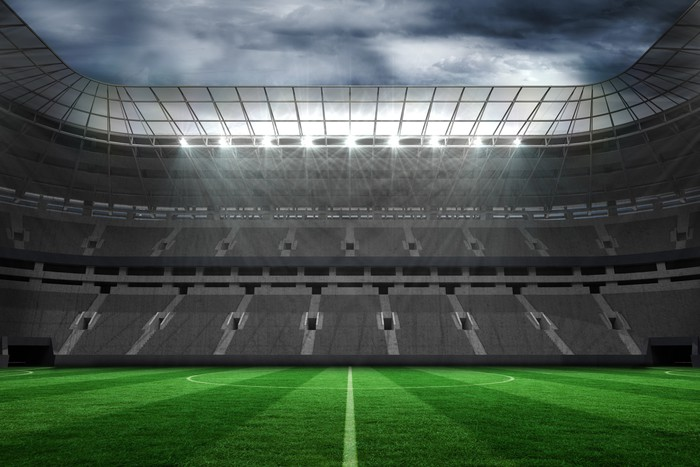 Empty football stadium under clouds Wall Mural Pixers We live