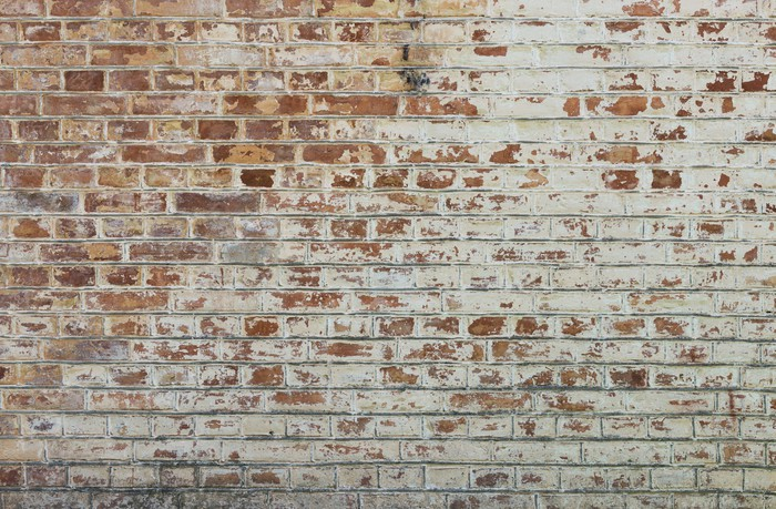 background of old vintage dirty brick wall with peeling plaster wall