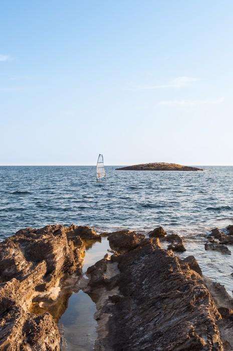 Carta da parati rocce in riva al mare pixers viviamo for Carta da parati casa al mare