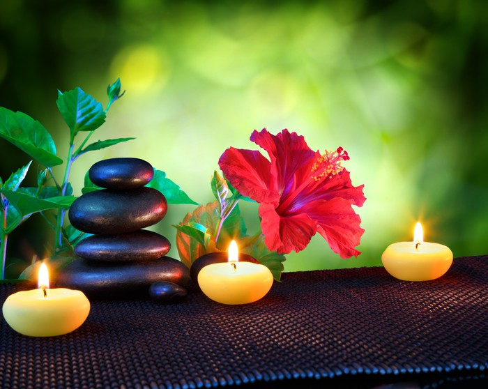 candles and stones spa composition with hibiscus wall mural