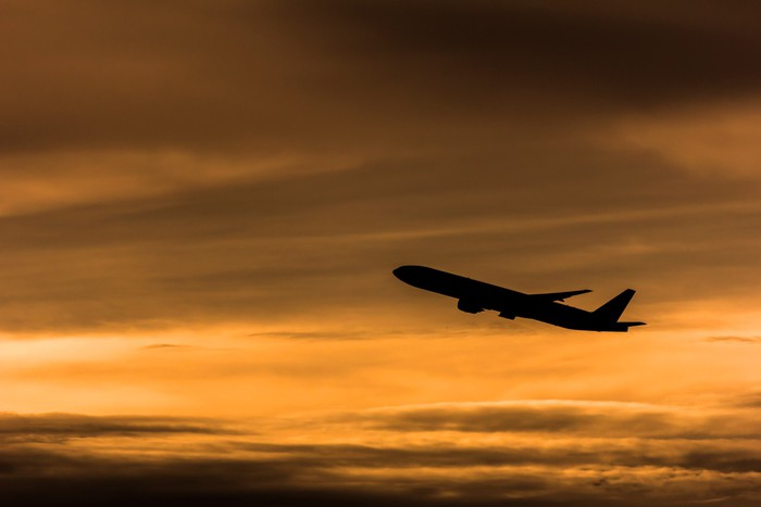 Silhouette airplane in the sunset sky Vinyl Wallpaper - Air