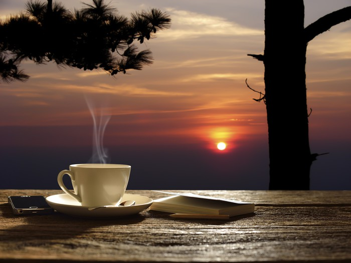 Morning cup of coffee with sunrise background Wall Mural • Pixers ...