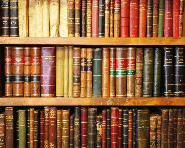 Carta da parati vecchi libri libreria biblioteca for Carta da parati vinile