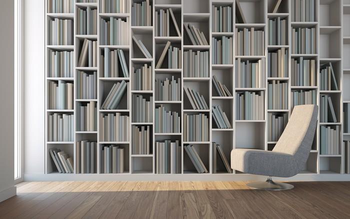 papier peint salle de jeux avec un fauteuil et dune bibliothque