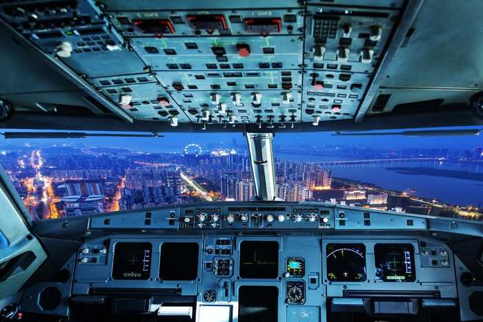 Plane cockpit and city of night wall mural pixers we for Cockpit wall mural