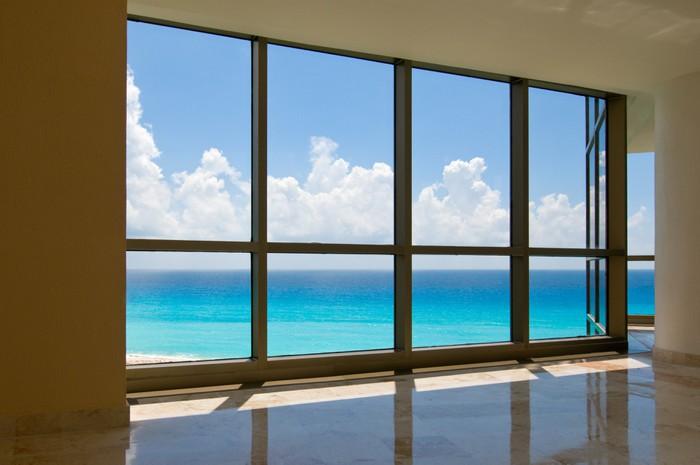 view of tropical beach through hotel windows wall mural vinyl